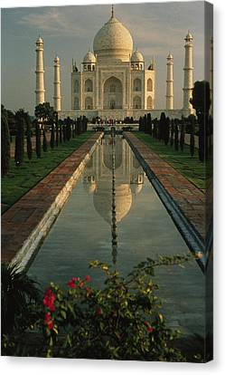 The Taj Mahal With A Reflection Canvas Print by Ed George