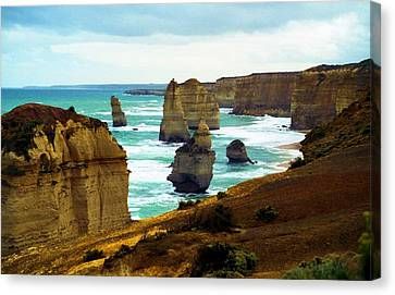 Canvas Print featuring the photograph The Twelve Apostles - Lost Apostle by Dennis Lundell