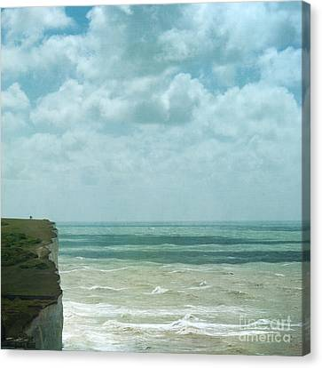 The Waves Bellow Us Canvas Print by Paul Grand