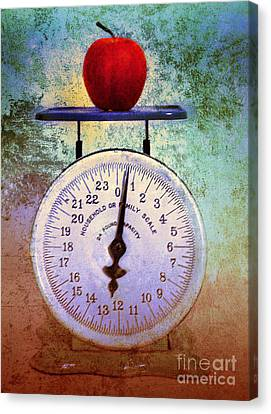 The Weight Of An Apple Canvas Print by Tara Turner