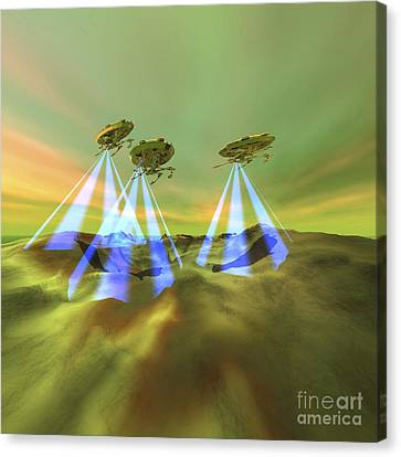 Three Alien Spaceships Steal Canvas Print by Corey Ford