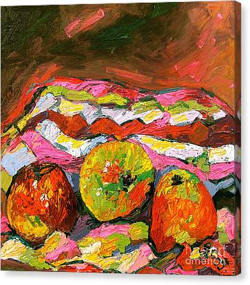 Three Apples On Patterned Cloth Canvas Print by Ginette Callaway