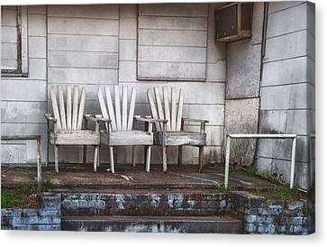 Three Chairs Beyond Front Street Canvas Print by Brenda Bryant