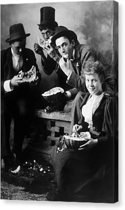 Three Men And A Woman Eating Canvas Print by Everett