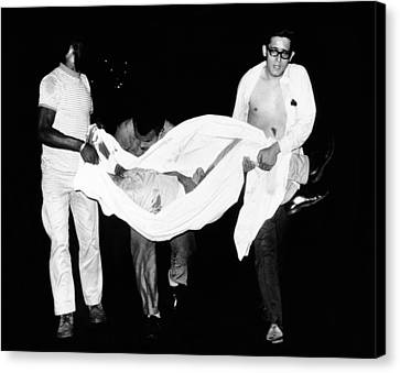 Three Men Carry Body Of A Youth Who Canvas Print by Everett