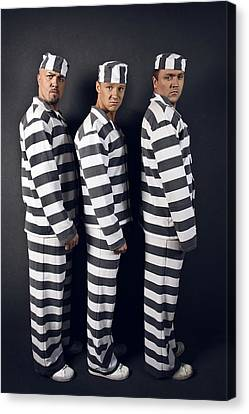 Three Prisoners. Group Of Men In Suits Of Convicts. Canvas Print by Kireev Art