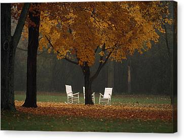 Three Welcoming Rocking Chairs Under An Canvas Print by Paul Chesley