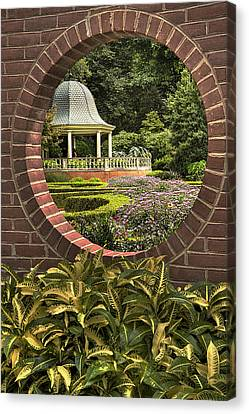 Through The Garden Wall Canvas Print by William Fields