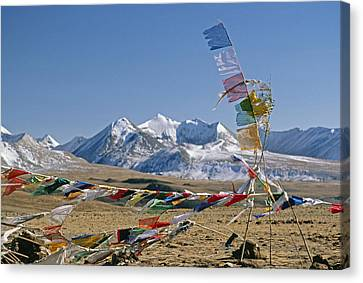 Tibetan Buddhist Prayer Flags Atop Pass Canvas Print by Gordon Wiltsie