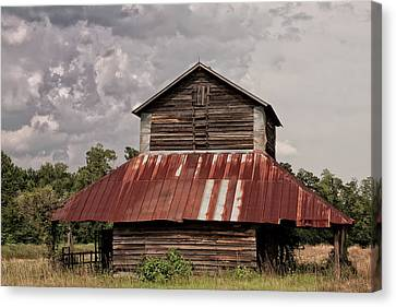 Tobacco Barn On Stormy Day Canvas Print by Sandra Anderson