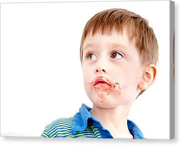 Toddler Eating Chocolate Canvas Print by Tom Gowanlock