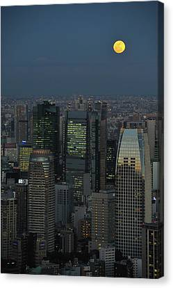 Tokyo And Full Moon Canvas Print by Vladimir Zakharov