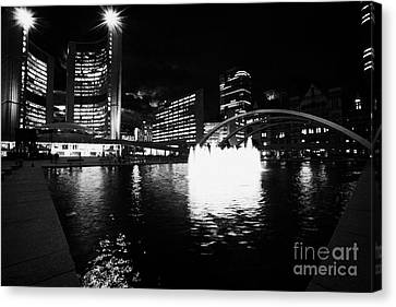 Toronto City Hall Building And Reflecting Pool In Nathan Phillips Square At Night Canvas Print by Joe Fox
