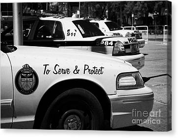 Toronto Police Squad Cars Outside Police Station In Downtown Toronto Ontario Canada Canvas Print by Joe Fox