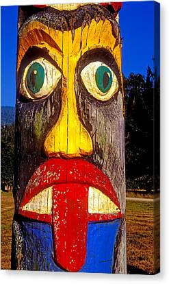 Totem Pole With Tongue Sticking Out Canvas Print by Garry Gay