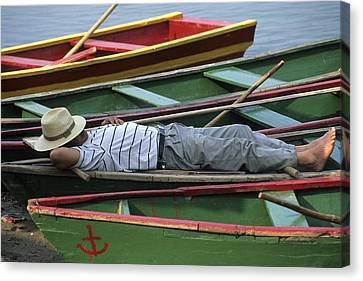 Tour Boat Guide Naps Amidst Rowboats Canvas Print by Raymond Gehman