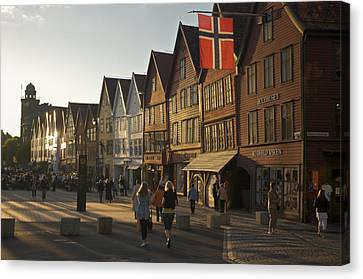 Tourists Walking In A Street In Bergen Canvas Print by Michael Melford
