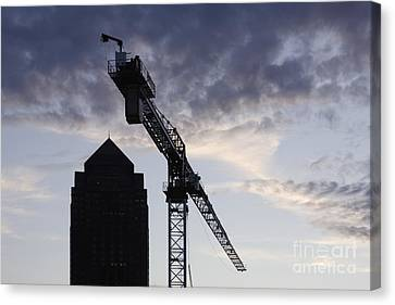Tower Crane With Building Silhouette In Background Canvas Print by Jeremy Woodhouse