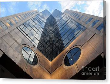 Towering Modern Skyscraper In Downtown Canvas Print by Gary Whitton