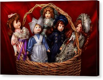 Toy - Dolls - A Basket Of Victorian Dolls  Canvas Print by Mike Savad