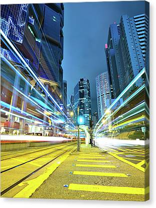 Long Street Canvas Print - Traffic Trails In City by Leung Cho Pan