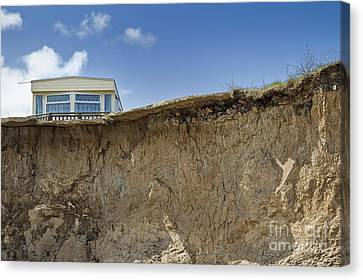 Trailer On Edge Of Cliff Canvas Print by Jon Boyes