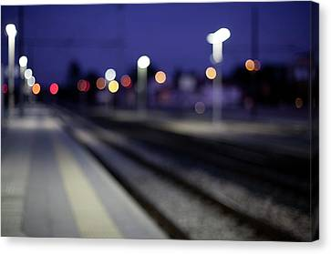 Train Tracks At Night Canvas Print by Francesca Guadagnini