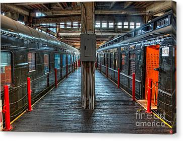 Trains - Two Rail Cars In Roundhouse Canvas Print by Dan Carmichael