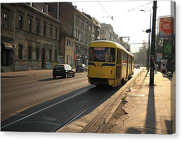 Tramway In The Morning Light Canvas Print by Frederic Vigne