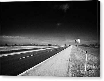 Trans Canada Highway 1 And Yellowhead Route In Manitoba Canada Canvas Print by Joe Fox