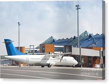 Transport Plane At The Airport Canvas Print by Jaak Nilson