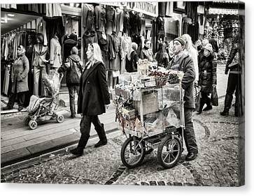 Traveling Vendor Canvas Print by Joan Carroll