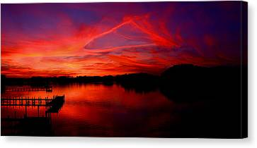 Triangle Of Fire Canvas Print by Tim Scullion