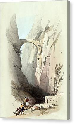 Triumphal Arch Across The Ravine Leading To Petra Canvas Print by Munir Alawi