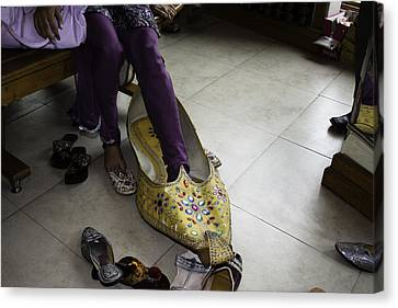 Trying On A Very Large Decorated Shoe Canvas Print by Ashish Agarwal