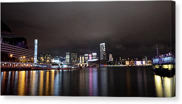 Tsim Sha Tsui - Kowloon At Night Canvas Print by Enrique Rueda