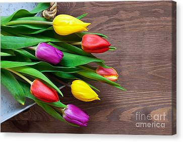 Tulips On The Table Canvas Print by Richard Thomas