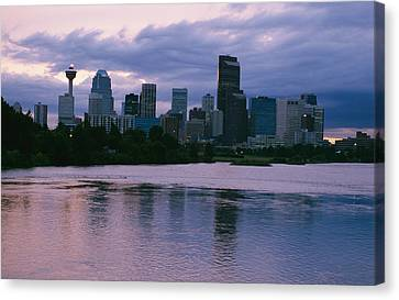 Twilight On The Bow River And Calgary Canvas Print by Michael S. Lewis