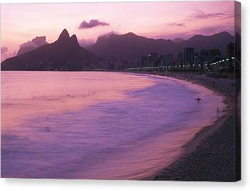 Twilight View Of Ipanema Beach And Two Canvas Print by Michael Melford