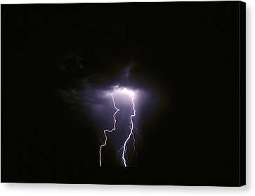 Twin Lightening Forks Slam Into A Salt Canvas Print by Jason Edwards