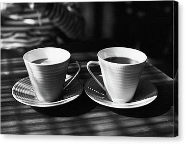 Two Cups Of Coffee In Sunlight Canvas Print by Breeze.kaze