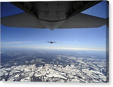 Two Ec-130j Commando Solo Aircraft Fly Canvas Print by Stocktrek Images