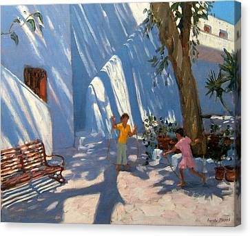Two Girls Skipping Mykonos Canvas Print by Andrew Macara