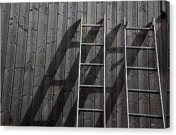 Cabin Wall Canvas Print - Two Ladders Leaning Against A Wooden Wall by Meera Lee Sethi