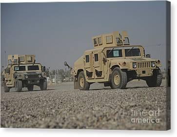 M1114 Canvas Print - Two M1114 Humvee Vehicles At Camp Taji by Stocktrek Images