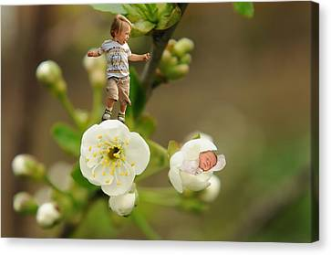 Two Tiny Kids Playing On Flowers Canvas Print by Jaroslaw Grudzinski