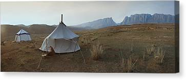 Two Traditional Yurts On A Flat Plain Canvas Print