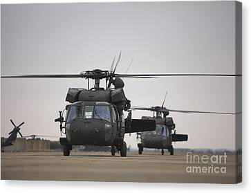 Two Uh-60 Black Hawks Taxi Canvas Print by Terry Moore