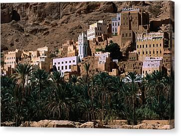Typical Hadramawt Village With Date Plantation In Foreground, Wadi Daw'an, Yemen Canvas Print by Frances Linzee Gordon