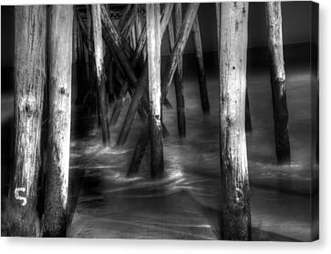 Under The Pier Canvas Print by Paul Ward